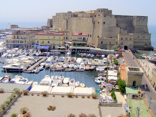 Castel dell'Ovo with the yachts and harbourside restaurants of Borgo Marinari in the foreground