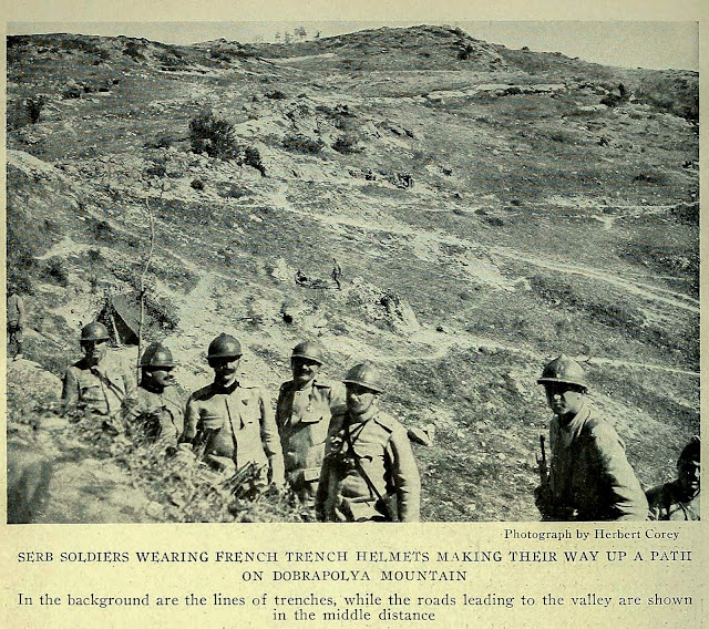 SERB SOLDIERS WEARING FRENCH TRENCH HELMETS MAKING THEIR WAY UP A PATH ON DOBRAPOLYA MOUNTAIN Photograph by Herbert Corey In the background are the lines of trenches, while the roads leading to the valley are shown in the middle distance