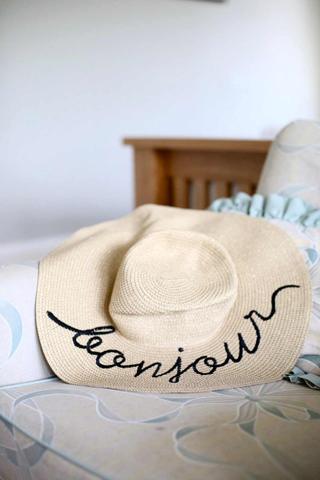 floppy hat with writing on