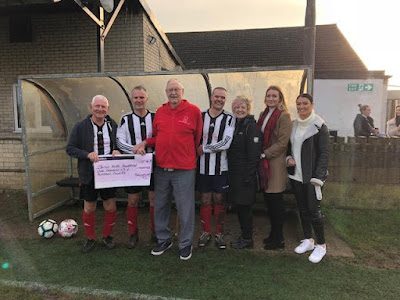 Picture: A cheque for £1,600 being presented to the British Heart Foundation in December 2018 with Adrian Gibbons' family present at the ceremony - see Nigel Fisher's Brigg Blog