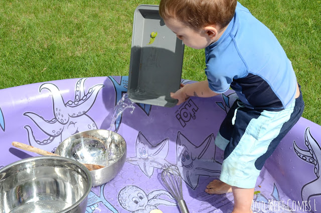 Preschooler pouring water in a kiddie pool as part of a music science experiment for kids