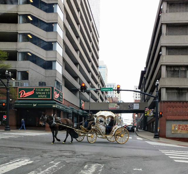 Demos Restaurant and horse drawn carriage Commerce St. Nashville