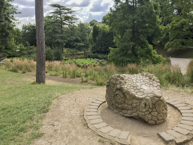 Crystal Palace Park dinosaur lake, 12 August 2016.  Spare head in the foreground.