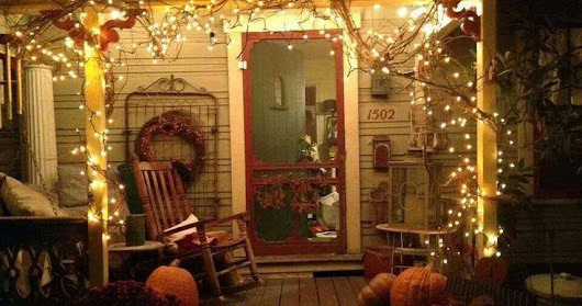 Create an inviting Front Porch with Honeysuckle Grapevine Garland and Brown Wire String Lights