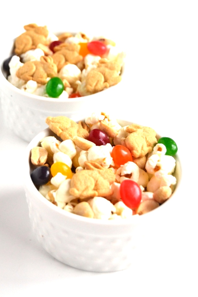 Spring Snack Mix takes 5 minutes to make and can be made with whatever ingredients you have on hand for a fun treat! www.nutritionistreviews.com