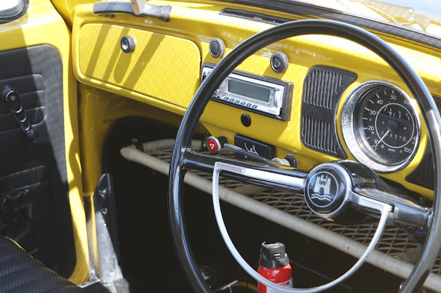 a bright yellow car dashboard