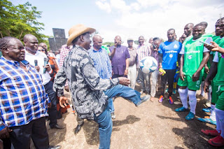 Raila Odinga playing football at Homabay. While CORD MPS failed to secure the electronic system. PHOTO | Awour