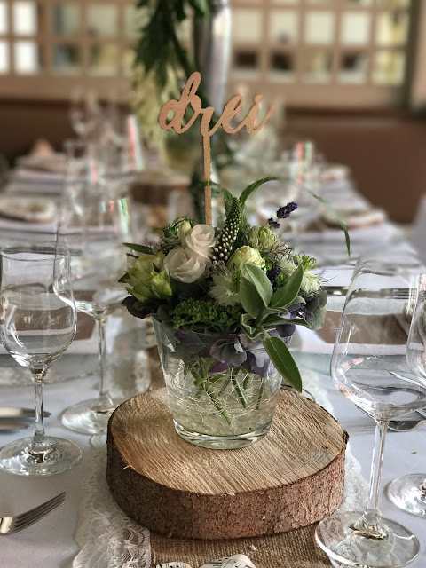 Wooden table numbers, Table decor with Hessians, wood, grey, brown, green, lilac, Wedding abroad, Mountain wedding lake-side at the Riessersee Hotel Resort Bavaria, Germany, Garmisch-Partenkirchen