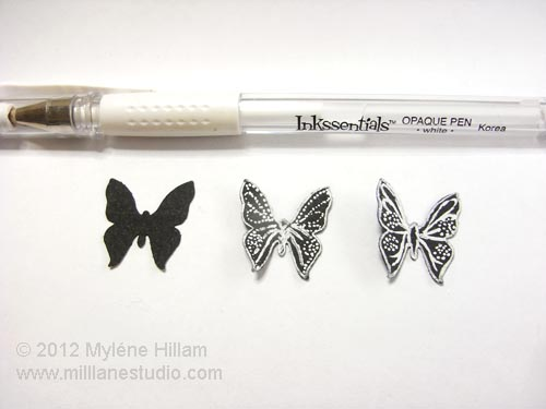 Black card stock butterflies with white detailing.