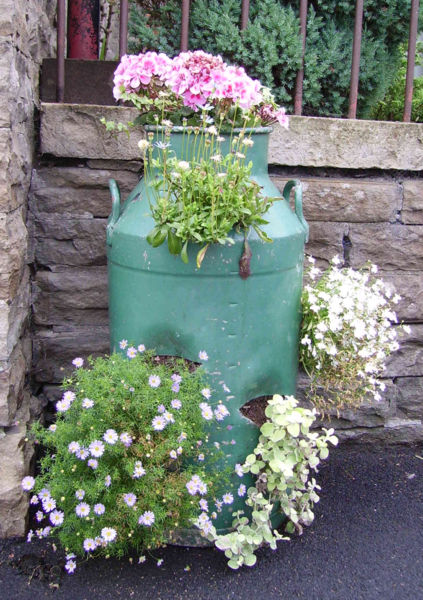 Is Displayed On This Milk Can From Ostfildern South Of Stuttgart Whilst In Hawes North Yorkshire The Churn Put To Use As A Planter For Flowers