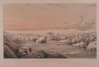 Icebergs in a channel with a pink sky backdrop