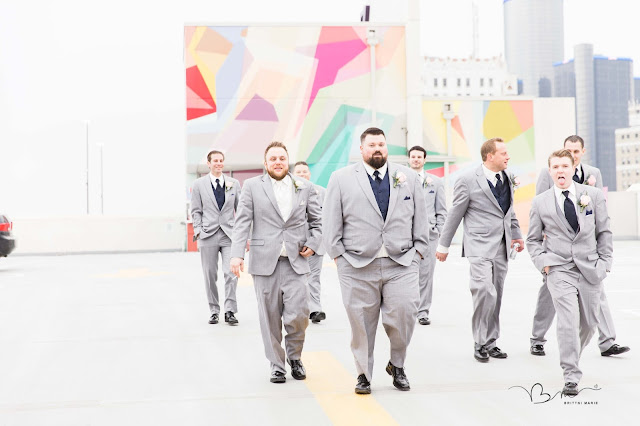 groomsmen on rooftop at z belt lot walking