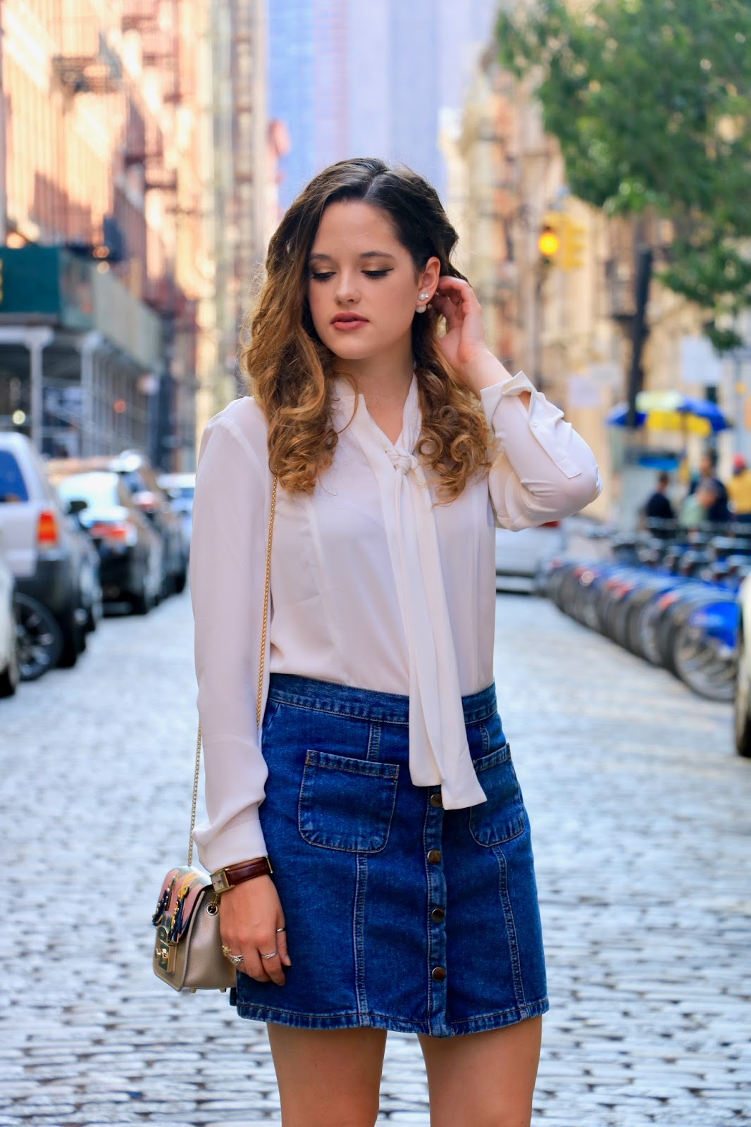 Fashion blogger Kathleen Harper showing how to wear a denim skirt