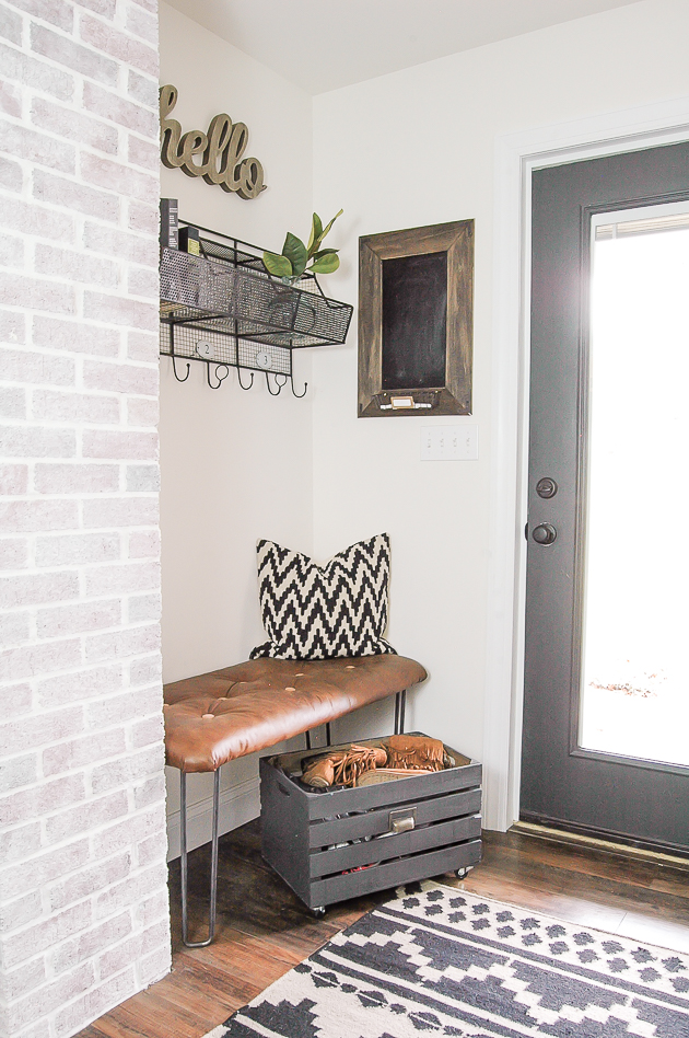 styling and rotating pillows on a mudroom bench