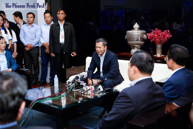 Hun Manet (centre) talks with reporters yesterday morning at the Phnom Penh International Airport after returning from a trip to Australia. Pha Lina