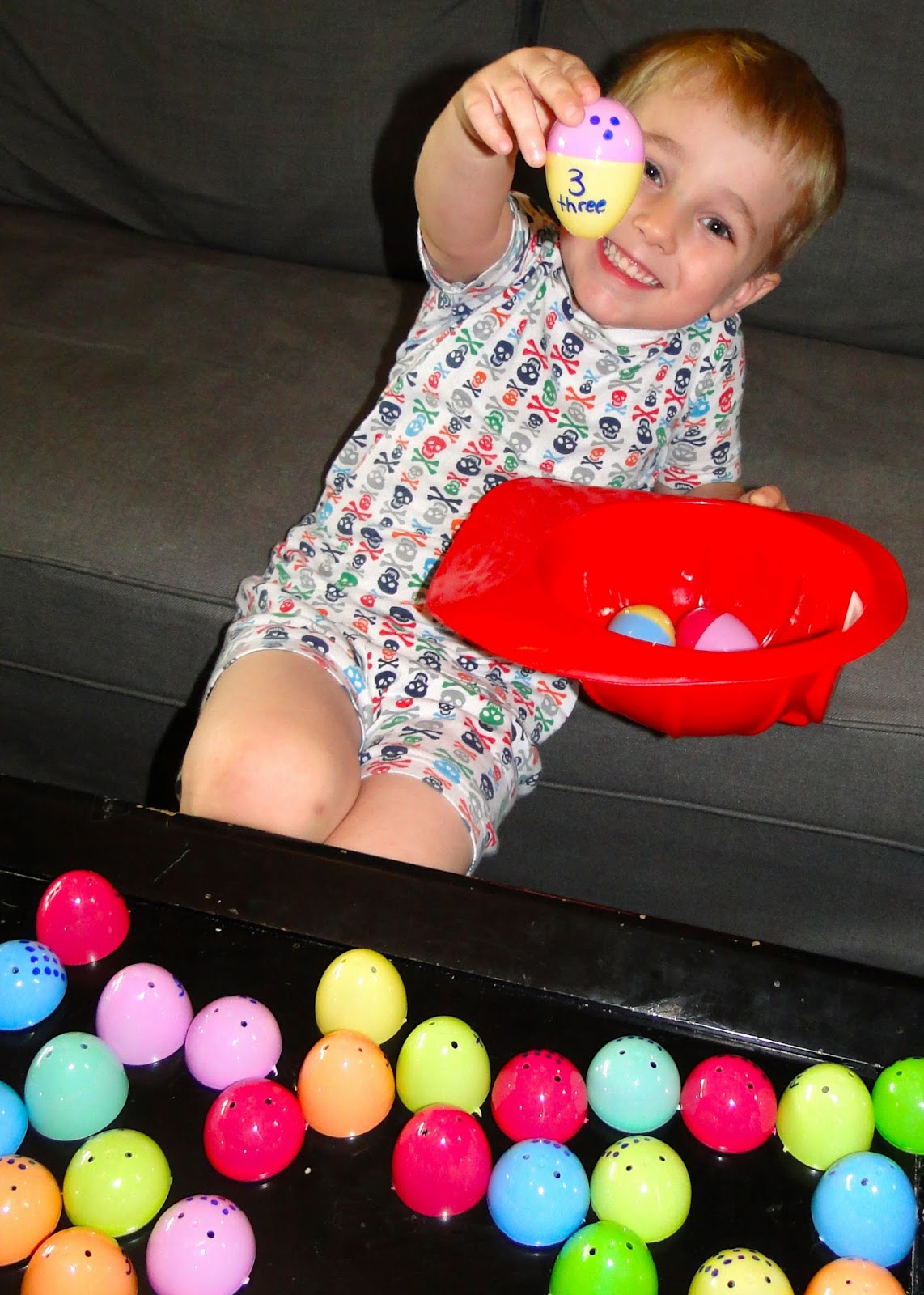 Child playing with toy eggs