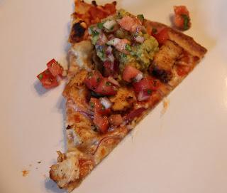 slice of chicken burrito pizza on white plate