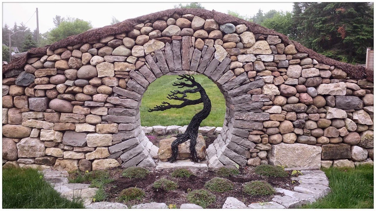 Thinking with my hands tree sculpture installed for Stone wall art