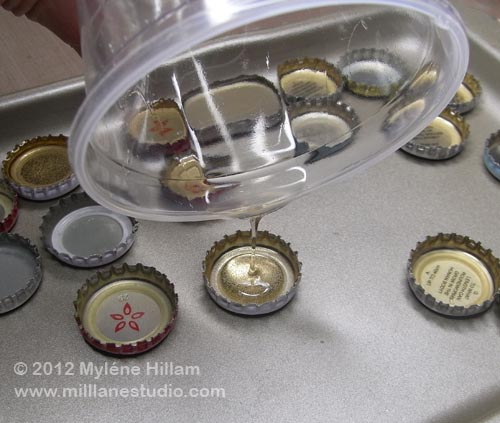 Pouring resin into bottle caps to the top of the cap
