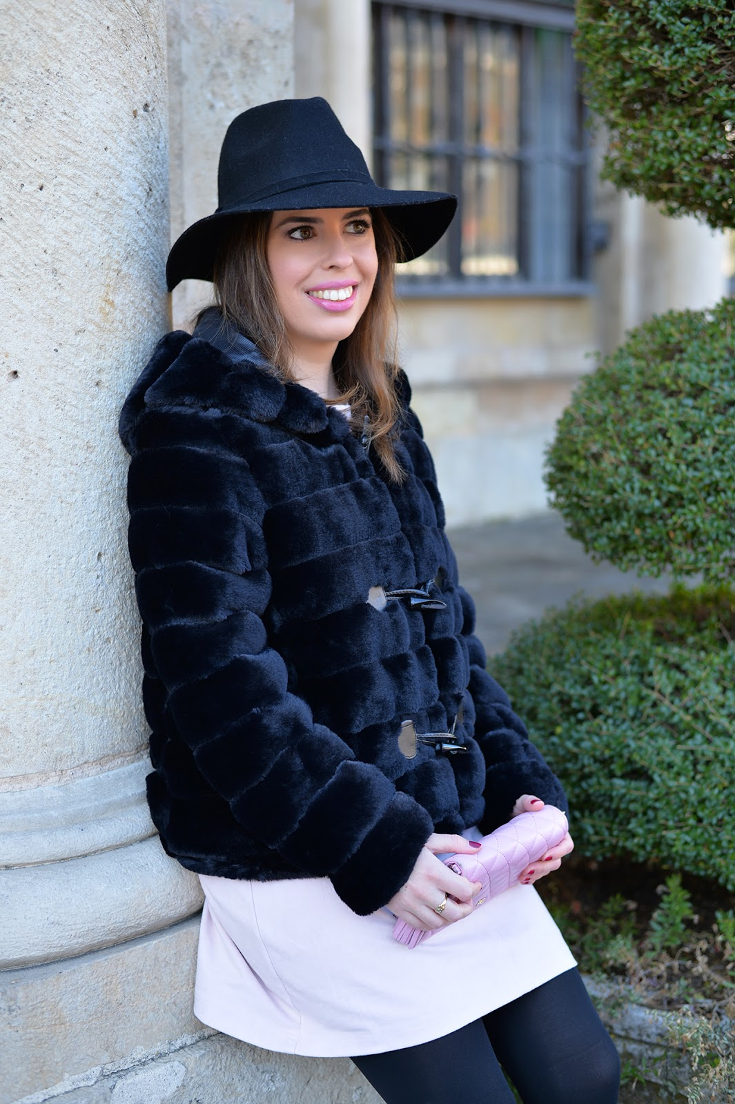 pink faux suede dress and a black faux fur coat holiday outfit