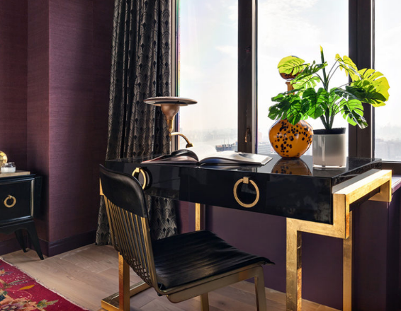 The black and gold geo desk is another eye-catchy feature here, and the chair is matching