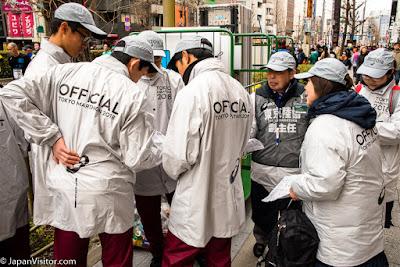 Group of officials at the Tokyo Marathon 2018, Asakusabashi, Tokyo, Japan.