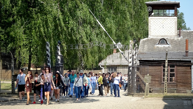 Watching people walking into Auschwitz