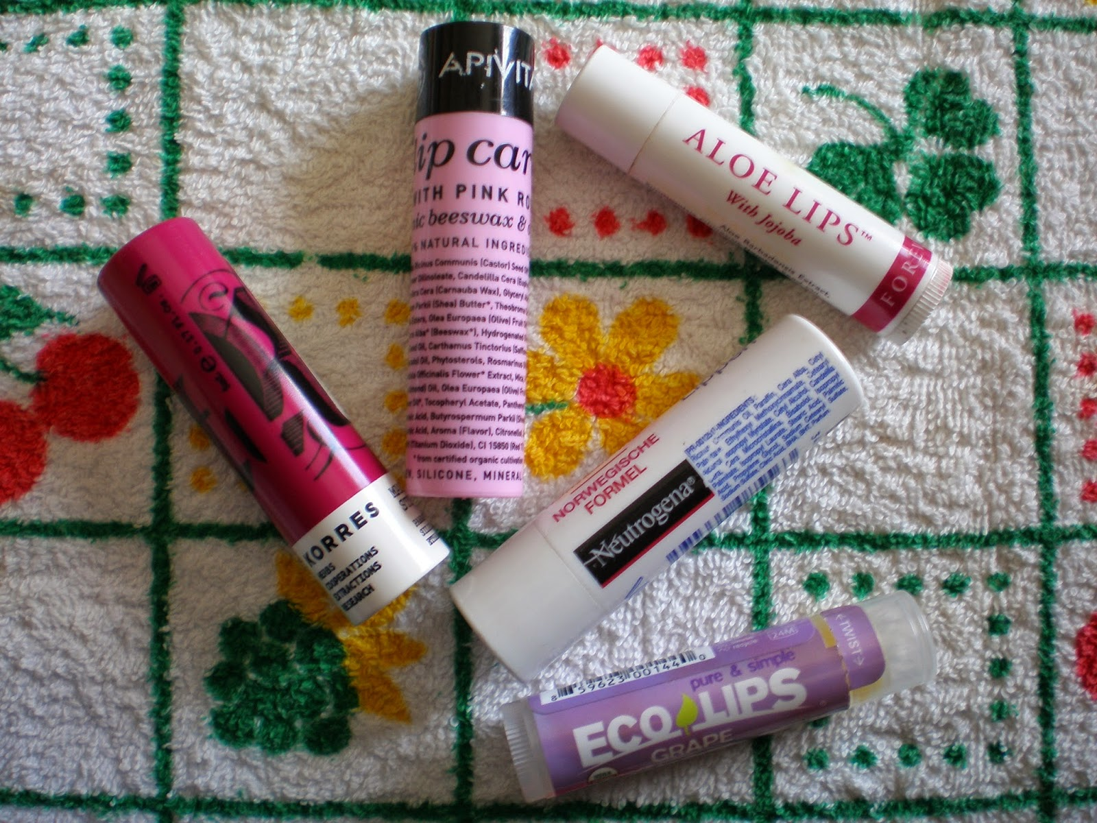 Apivita lip care with pink rose, Korres lip butter stick SPF15 in Purple, Eco Lips, Neutrogena, Forever Living Aloe Lips