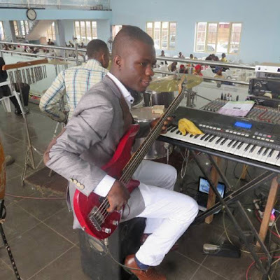Nigerian bass guitarist playing okaka