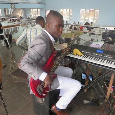 Nigerian bass guitarist playing okaka