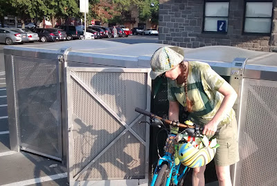Cynthia M. Parkhill wheels her bicycle out of a BikeLink bicycle locker