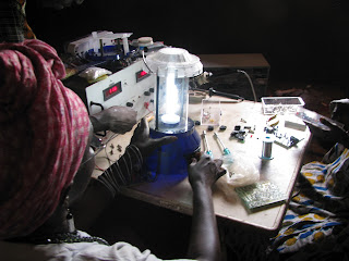 Fatima Seidi finishing solar lanterns in Mambonko