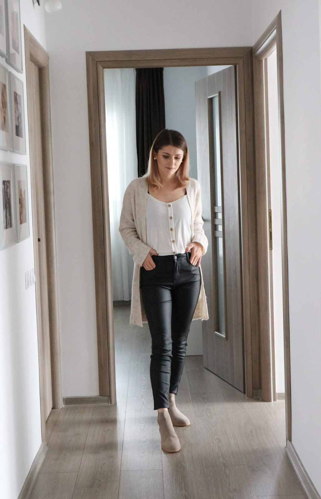 black coated jeans and camel cardigan