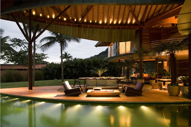 Picture of open living room by the pool