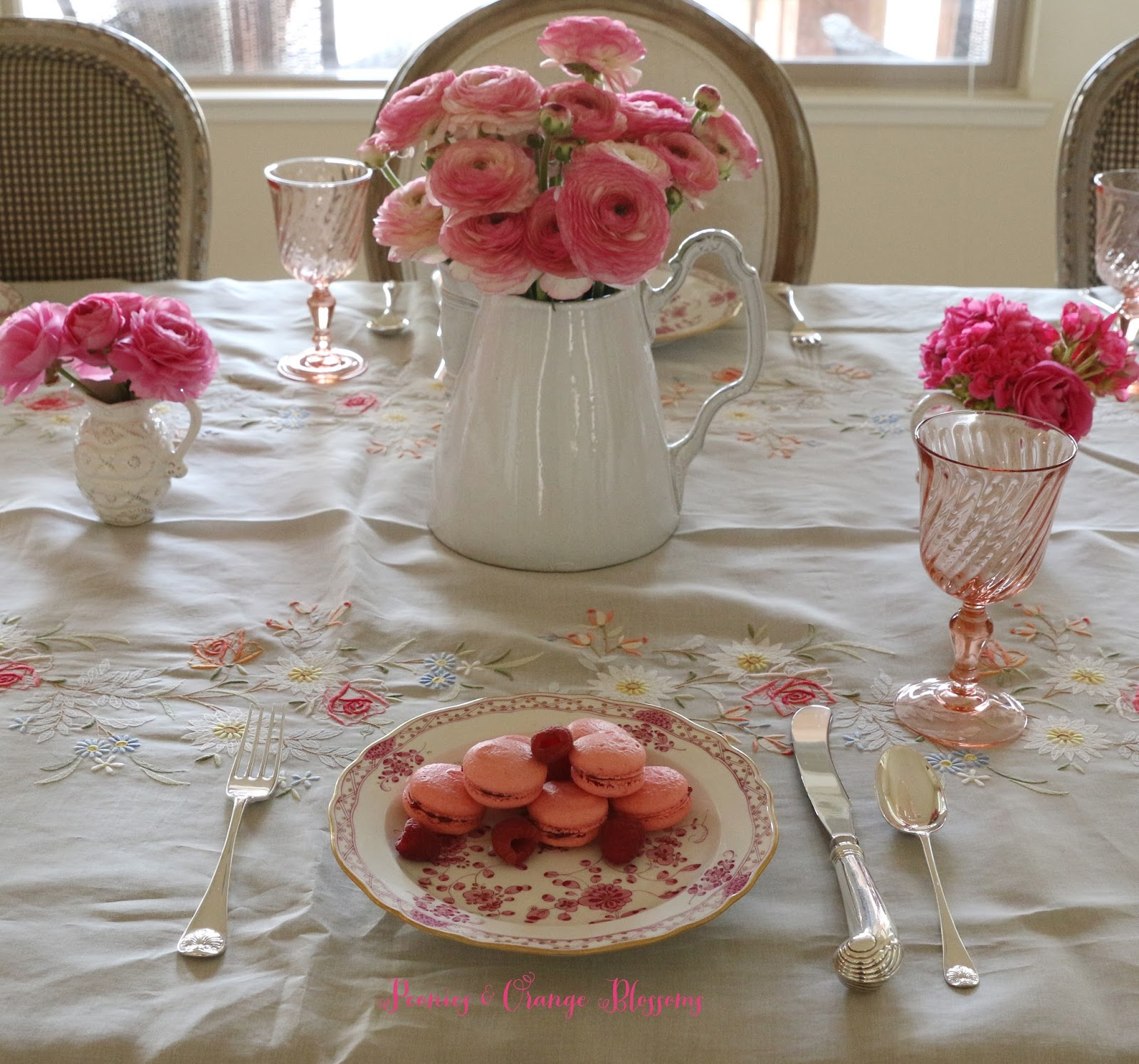 French table setting with Meissen plates, Astier de Villate pitcher, and pink ranunculus