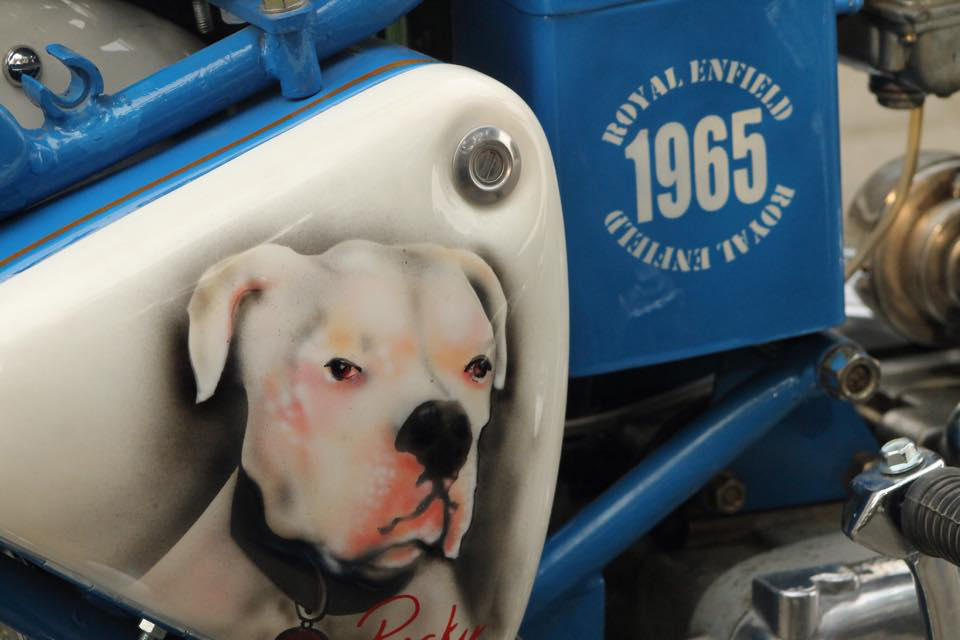 Picture of dog painted on Royal Enfield motorcycle.