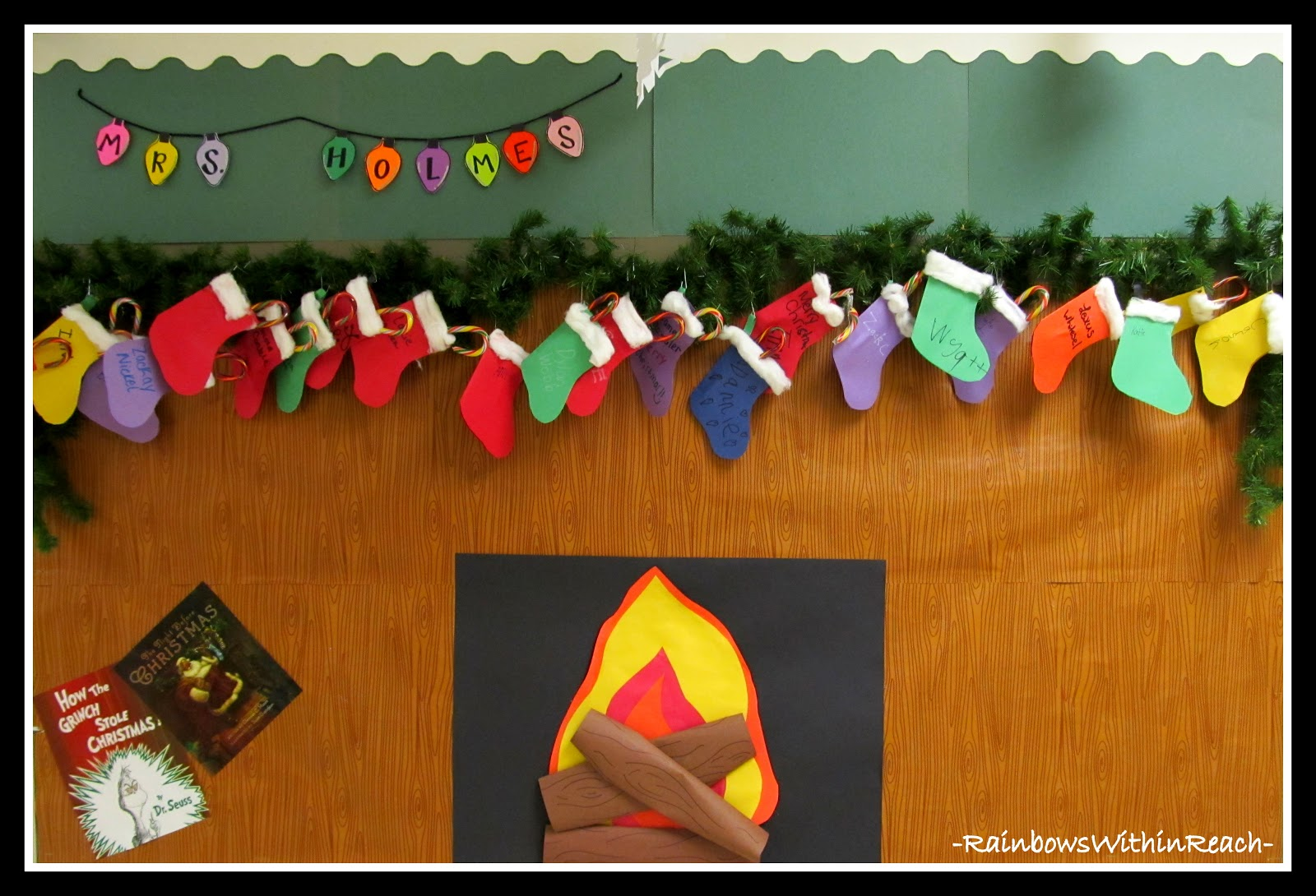 Photo Of Fireplace Glowing With Decorated Stockings Bulletin Board Via Christmas RoundUP