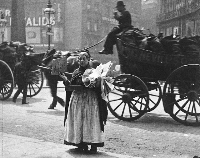 Senior woman on the street corner, selling papers. Victorian London.Speak Your Mind and other stories of Grandmas and reason. marchmatron.com