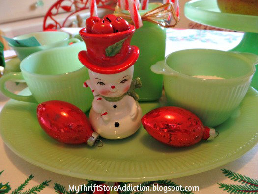 A Holly Jolly Jadeite Kitchen mythriftstoreaddiction.blogspot.com Jadeite table setting with vintage ornaments and snowman