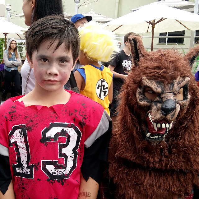 kids werewolf costume and zombie football player