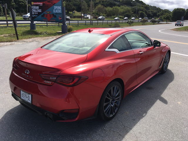 Rear 3/4 view of 2017 Infiniti Q60 Red Sport 400