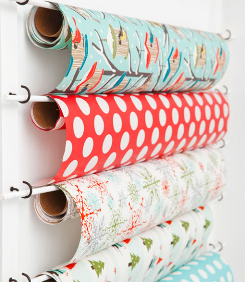 Use eye hooks and dowels to store wrapping paper