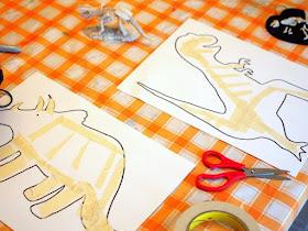 apply masking tape for tape resist dinosaur STEM and art project