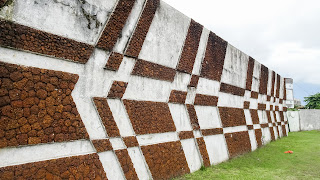 Stone wall with brown and white painting