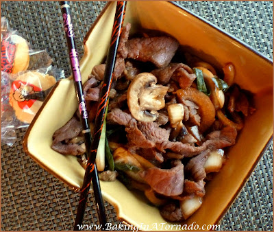 Crockpot Oriental Steak: An easy crockpot dinner loaded with oriental flavors. The steak is marinated, sliced and cooked slowly for 4 to 6 hours for an easy meal. | Recipe developed by www.BakingInATornado.com | #recipe #dinner #crockpot