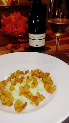 A plate with risotto and squash paired with a Pinot Gris of Franconia