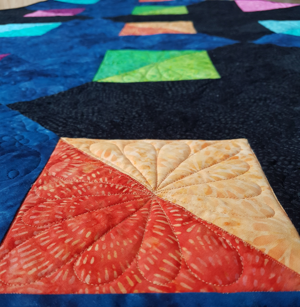 free motion quilting in triangles | DevotedQuilter.com