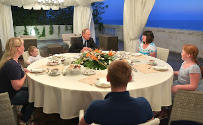 Vladimir Putin with Anastasia Votintseva and her sister and children in the Bocharov Ruchei residence.