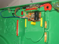 Bottom of farm toy showing ICD header board and resistors for LEDs