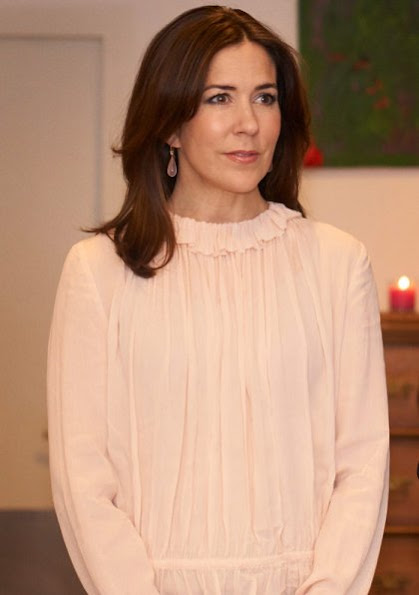 Crown Princess Mary wearing a great blue coat, a white blouse and printed pants. visited the Red Cross with the Mary Foundation